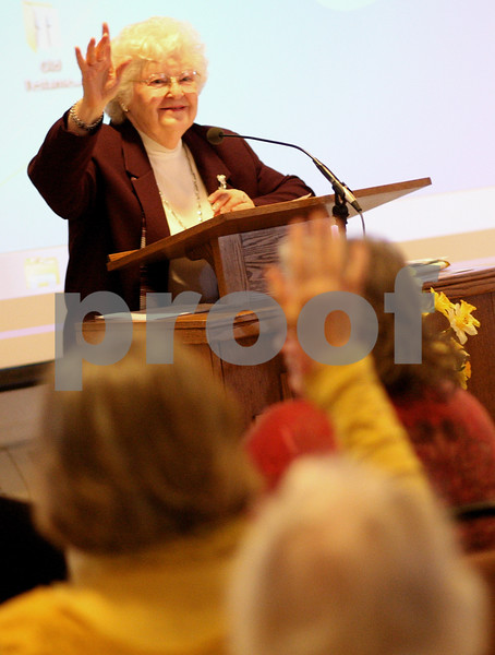 Kyle Bursaw – kbursaw@shawmedia.com<br /> <br /> Elaine Goodwin asks for a raise of hands of people who have been to France during the World Day of Prayer at First Baptist Church in DeKalb, Ill. on Friday, March 1, 2013.
