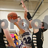 Rob Winner – rwinner@shawmedia.com<br /> <br /> Hampshire's Ryan Cork (32) puts up a shot over Sycamore's Devin Mottet in the second quarter during the Class 3A Burlington Central Regional final in Burlington, Ill., Friday, Mar. 1, 2013.