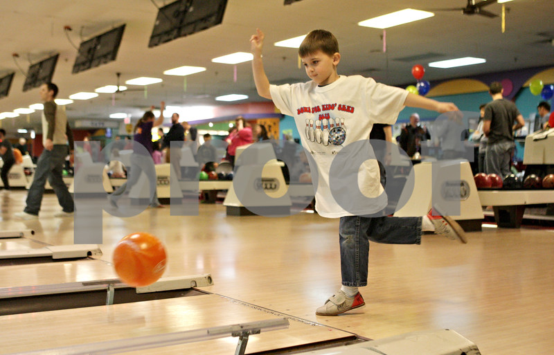 Rob Winner – rwinner@shawmedia.com<br /> <br /> Six-year-old Cody Allen, bowling with TBC Net, participates in the Bowl for Kids' Sake event Friday evening at Mardi Gras Lanes in DeKalb.<br /> <br /> ***Please do not run as lead. It is not a strong image. - Rob***