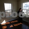 Kyle Bursaw – kbursaw@shawmedia.com<br /> <br /> Century 21 Elsner Realty Broker Maria Peña-Graham makes a phone call to get answers to questions her clients had about their new Cortland home during a final walk-through on Monday, Feb. 25, 2013.