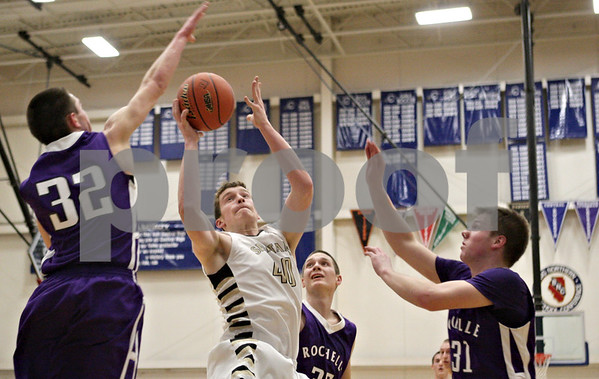 Rob Winner – rwinner@shawmedia.com<br /> <br /> Sycamore's Scott Nelson (40) takes a shot in the second quarter during the Class 3A Burlington Central Regional semifinals in Burlington, Ill., Wednesday, Feb. 27, 2013.