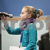 Rob Winner – rwinner@shawmedia.com<br /> <br /> Grace Federici, 10, from St. Mary School in DeKalb, adjusts the microphone before her turn in the first round during the DeKalb County Spelling Bee at Kishwaukee College in Malta, Ill., Saturday, Feb. 23, 2013.