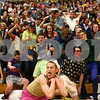 Kyle Bursaw – kbursaw@shawmedia.com<br /> <br /> Sycamore student Colin Eggleson (bottom) looks to the DeKalb student section after leading his student section in a cheer at half-time where he pretends to be a boxer and the section reacts in unison to his punches at Sycamore High School on Friday, Feb. 22, 2013.