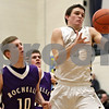 Rob Winner – rwinner@shawmedia.com<br /> <br /> Sycamore's Devin Mottet (right) controls a pass before making a shot in the fourth quarter during the Class 3A Burlington Central Regional semifinals in Burlington, Ill., Wednesday, Feb. 27, 2013.