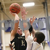 Rob Winner – rwinner@shawmedia.com<br /> <br /> Sycamore's Devin Mottet (15) puts up a shot over Hampshire's Tyler Crater in the fourth quarter during the Class 3A Burlington Central Regional final in Burlington, Ill., Friday, Mar. 1, 2013. Sycamore defeated Hampshire, 51-44.