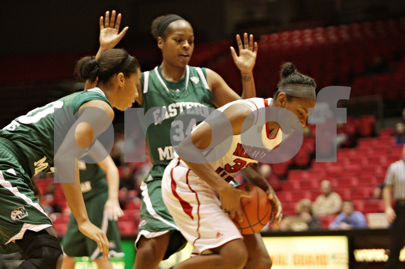 Rob Winner – rwinner@shawmedia.com<br /> <br /> Northern Illinois center Shaakira Haywood (right) tries to regain control of a ball while driving past two Eastern Michigan defenders in the first half at the Convocation Center in DeKalb, Ill., Thursday, Feb. 28, 2013.