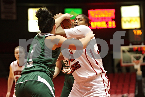 Rob Winner – rwinner@shawmedia.com<br /> <br /> Northern Illinois forward Natecia Augusta (right) is called for traveling while being pressured by Eastern Michigan's Taylor Bird in the first half at the Convocation Center in DeKalb, Ill., Thursday, Feb. 28, 2013.