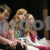 Rob Winner – rwinner@shawmedia.com<br /> <br /> Cecilia Snider (center), 13, of Hiawatha Jr. High School, prepares for her turn in the seventh round during the DeKalb County Spelling Bee at Kishwaukee College in Malta, Ill., Saturday, Feb. 23, 2013.