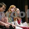 Rob Winner – rwinner@shawmedia.com<br /> <br /> Cecilia Snider (center), 13, of Hiawatha Jr. High School, prepares for her turn in the seventh round during the DeKalb County Spelling Bee at Kishwaukee College in Malta, Ill., Saturday, Feb. 23, 2013.