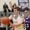 Rob Winner – rwinner@shawmedia.com<br /> <br /> Sycamore's Scott Nelson (center) passes the ball while being pressured by two Rochelle defenders in the second quarter during the Class 3A Burlington Central Regional semifinals in Burlington, Ill., Wednesday, Feb. 27, 2013.