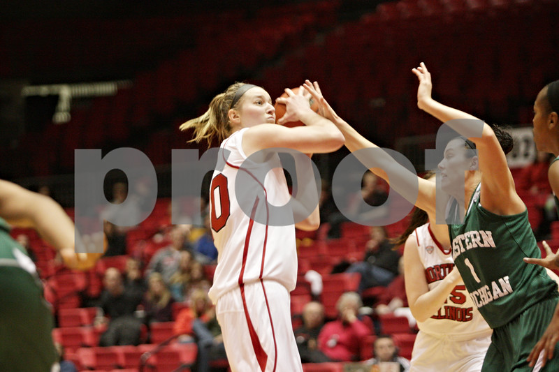 Rob Winner – rwinner@shawmedia.com<br /> <br /> Northern Illinois forward Jenna Thorp (left) looks to shoot while being pressured by Eastern Michigan's Taylor Bird in the first half at the Convocation Center in DeKalb, Ill., Thursday, Feb. 28, 2013.
