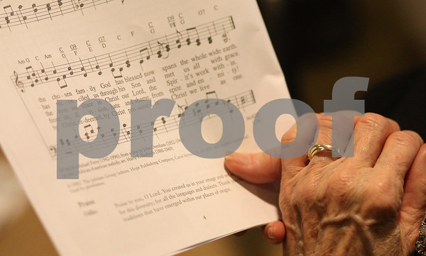 Kyle Bursaw – kbursaw@shawmedia.com<br /> <br /> A woman holds her sheet music while singing at song during World Day of Prayer at First Baptist Church in DeKalb, Ill. on Friday, March 1, 2013.