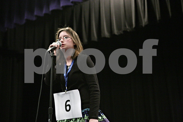 "Rob Winner – rwinner@shawmedia.com<br /> <br /> Samantha Anderson, 13, of Clinton Rosette Middle School, correctly spells the word ""coyote"" in the second round during the DeKalb County Spelling Bee at Kishwaukee College in Malta, Ill., Saturday, Feb. 23, 2013."