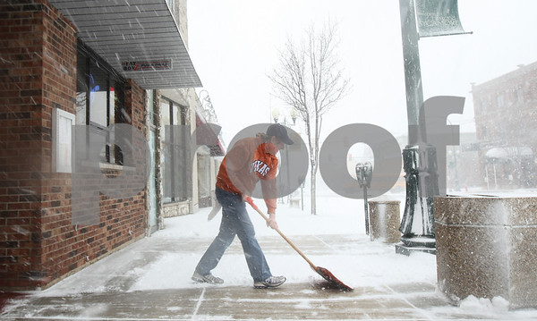 Kyle Bursaw – kbursaw@shawmedia.com<br /> <br /> Fat Boyz bartender Mike Jenkin shovels in front of the establishment on Tuesday, Feb. 26, 2013.