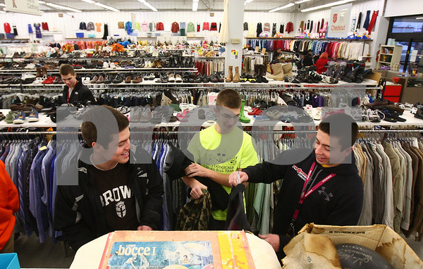 Kyle Bursaw – kbursaw@shawmedia.com<br /> <br /> Sycamore students Henry Johnson (from left), Jon Cordes and Mookie Stinnett shop clothes at Salvation Army in DeKalb, Ill. on Thursday, Feb. 21, 2013 for their student section's thrift shop theme night the next day during the basketball game against DeKalb.