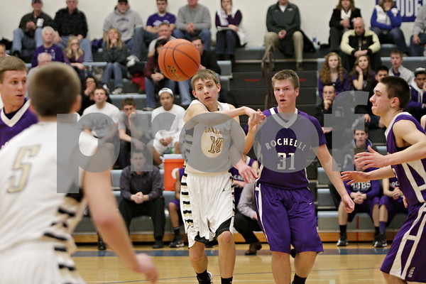 Rob Winner – rwinner@shawmedia.com<br /> <br /> Sycamore's Nicholas Feuerbach (10) passes the ball to Jacob Winters (5) in the second quarter during the Class 3A Burlington Central Regional semifinals in Burlington, Ill., Wednesday, Feb. 27, 2013.