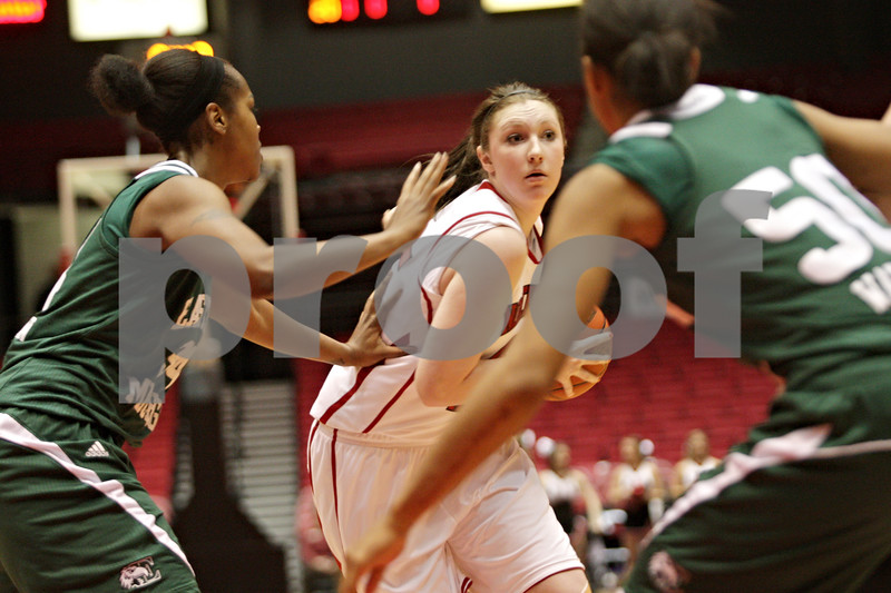 Rob Winner – rwinner@shawmedia.com<br /> <br /> Northern Illinois center McKenzie Hoelmenn (center) looks to pass in the first half at the Convocation Center in DeKalb, Ill., Thursday, Feb. 28, 2013.