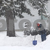 Kyle Bursaw — kbursaw@shawmedia.com<br /> <br /> DeKalb resident Connie Schorsch takes a moment to rest while shoveling her driveway on Fisk Avenue in DeKalb, Ill. on Tuesday, March 5, 2013.