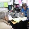 Kyle Bursaw – kbursaw@shawmedia.com<br /> <br /> Debbie Beranek (right), an information & assistance specialist for the Elder Care Services in DeKalb, helps Herbert and Laverne Selman make sense of their medical bills on Wednesday, Feb. 27, 2013.