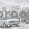 Kyle Bursaw — kbursaw@shawmedia.com<br /> <br /> A car (at left) spins its wheels, unable to get traction to get up the incline on North First Street in DeKalb, Ill. on Tuesday, March 5, 2013.