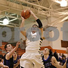 Rob Winner – rwinner@shawmedia.com<br /> <br /> Sycamore's Devin Mottet (15) attempts a shot in the fourth quarter during the Class 4A Freeport Sectional semifinals in Freeport, Ill., Thursday, Mar. 7, 2013.