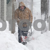 Kyle Bursaw — kbursaw@shawmedia.com<br /> <br /> William Walls, of Delano's Home Decorating, blows snow off of the sidewalk on North Fourth Street in DeKalb, Ill. on Tuesday, March 5, 2013.