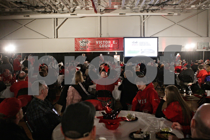 Rob Winner – rwinner@shawmedia.com<br /> <br /> Guests to the seventh annual Huskie Athletic Support Fund Kickoff Classic listen to Shelley Binegar speak on Saturday, March 2, 2013, inside Victor E. Court at the Convocation Center in DeKalb, Ill.