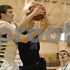 Rob Winner – rwinner@shawmedia.com<br /> <br /> Sycamore's Scott Nelson (left) and St. Francis'  Kevin McShea go up for a ball under Sycamore's basket in the first quarter during the Class 4A Freeport Sectional semifinals in Freeport, Ill., Thursday, Mar. 7, 2013.