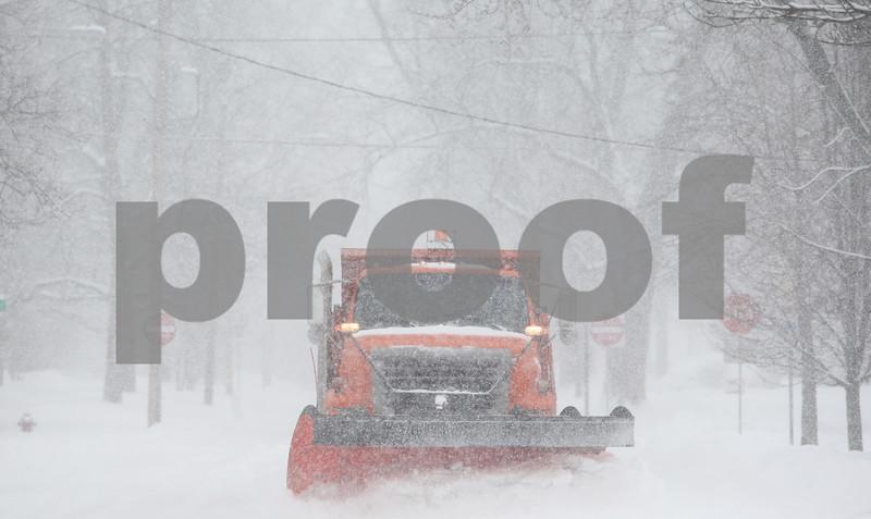 Kyle Bursaw — kbursaw@shawmedia.com<br /> <br /> A plow clears snow on North Second Street in DeKalb, Ill. on Tuesday, March 5, 2013.