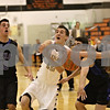 Rob Winner – rwinner@shawmedia.com<br /> <br /> Sycamore's Kyle Buzzard (22) loses the ball after St. Francis' Jason Pisarski (right) reaches for it in the second quarter during the Class 4A Freeport Sectional semifinals in Freeport, Ill., Thursday, Mar. 7, 2013.