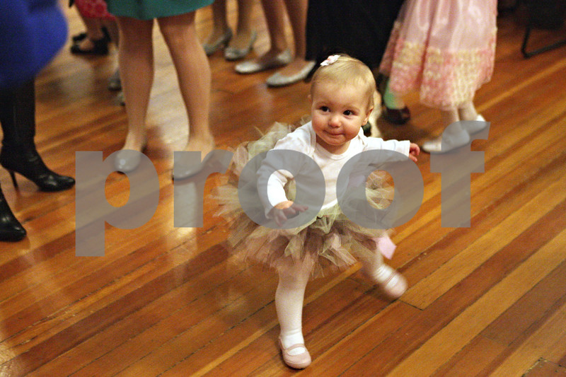 """Rob Winner – rwinner@shawmedia.com<br /> <br /> Lily Becker, 16 months old, of Sycamore, dances during the third annual Royal Children's Ball hosted by DeKalb County Youth Service Bureau at Altgeld Hall on the campus of Northern Illinois University in DeKalb, Ill., Friday, March 8, 2013. """"She's around music all the time and it shows,"""" said Lisa Becker, Lily's mother."""