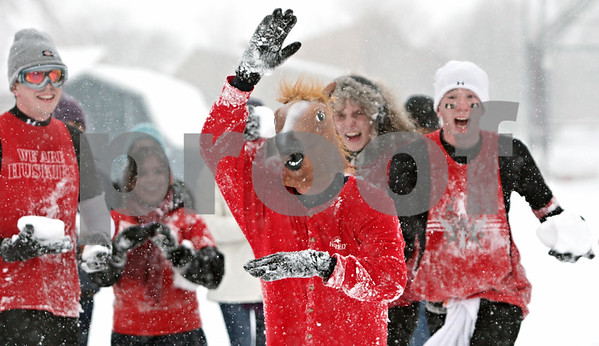 Rob Winner – rwinner@shawmedia.com<br /> <br /> A man wearing a horse mask leads a charge during a snowball fight outside University Plaza in DeKalb, Ill., Tuesday, March 5, 2013.