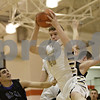 Rob Winner – rwinner@shawmedia.com<br /> <br /> Sycamore's Scott Nelson (40) controls an offensive rebound in the second quarter during the Class 4A Freeport Sectional semifinals in Freeport, Ill., Thursday, Mar. 7, 2013.