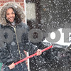 Kyle Bursaw – kbursaw@shawmedia.com<br /> <br /> Timothy Bowie flings snow at Alisha Prothero, 7, (not pictured) after she threw a snowball at Bowie while he was shoveling out his girlfriend's car in DeKalb, Ill. on Tuesday, March 5, 2013.