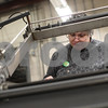 Kyle Bursaw – kbursaw@shawmedia.com<br /> <br /> Janet Freeman uses a machine to shrink wrap groups of folders in the Opportunity House's workshop in Sycamore, Ill. on Thursday, March 7, 2013.