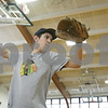 Rob Winner – rwinner@shawmedia.com<br /> <br /> Ed Canchola, a senior, practices pitching inside the gymnasium at Hiawatha High School in Kirkland, Ill., Saturday, March 9, 2013.