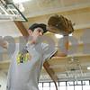Rob Winner – rwinner@shawmedia.com<br /> <br /> Ed Canchola, a senior, practices pitching inside the gymnasium at Hiawatha High School in Kirkland, Ill., Saturday, March 9, 2013.