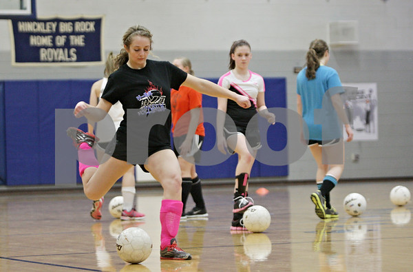 Rob Winner – rwinner@shawmedia.com<br /> <br /> Lauren Paver works on shootingJ during a drill at soccer practice at Hinckley-Big Rock High School on Wednesday, March 6, 2013.