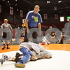 Rob Winner – rwinner@shawmedia.com<br /> <br /> BJ Murray, of Auburn Junior High School at Divernon, watches over wrestlers Mike Ushman (top) and Cole Maxedon between matches during the Illinois Elementary School Association Boys State Wrestling Tournament at the Convocation Center in DeKalb, Ill., Saturday, March 9, 2013.