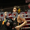Rob Winner – rwinner@shawmedia.com<br /> <br /> Tristin Rilea (front), of Canton Ingersoll, jogs in place while waiting for the start of his 90-pound match as coach Chris Piper looks on during the Illinois Elementary School Association Boys State Wrestling Tournament at the Convocation Center in DeKalb, Ill., Saturday, March 9, 2013.