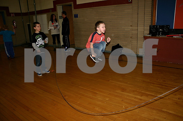 Dylan Lowry jumps as Asa Andrews swings the rope Friday at Kingston Elementary School as students participated in its annual Jump Rope for Heart event. (Stephanie Hickman - shickman@shawmedia.com)
