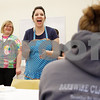 Erik Anderson - For the Daily Chronicle<br /> Evelyn Lorence, the Young Adult Librarian, applauds the contestants before the first round of the pie eating contest held at the Sycamore Public Library in Sycamore on Thursday, March 14, 2013. There were over 20 contestants during the first two rounds of pie eating.