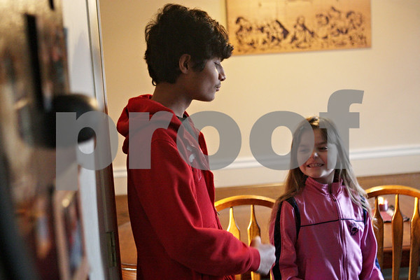 Rob Winner – rwinner@shawmedia.com<br /> <br /> Foreign exchange student Sharvil Patel (left), 15, interacts with Mackenzie Mitchell, 8, before dinner with the Wagnaar family of Cortland on Tuesday, March 12, 2013. Patel is the ninth exchange student the Wagnaar family has hosted.
