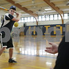 Rob Winner – rwinner@shawmedia.com<br /> <br /> Coach Sean Donnelly (right) tosses a ball as Nick Doolittle, a sophomore, works on his swing during practice inside the gymnasium at Hiawatha High School in Kirkland, Ill., Saturday, March 9, 2013.