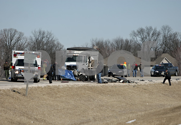 Rob Winner – rwinner@shawmedia.com<br /> <br /> Emergency personnel investigate the scene of a fatal accident north of Freed Road on Peace Road near Sycamore on Thursday, March 21, 2013.
