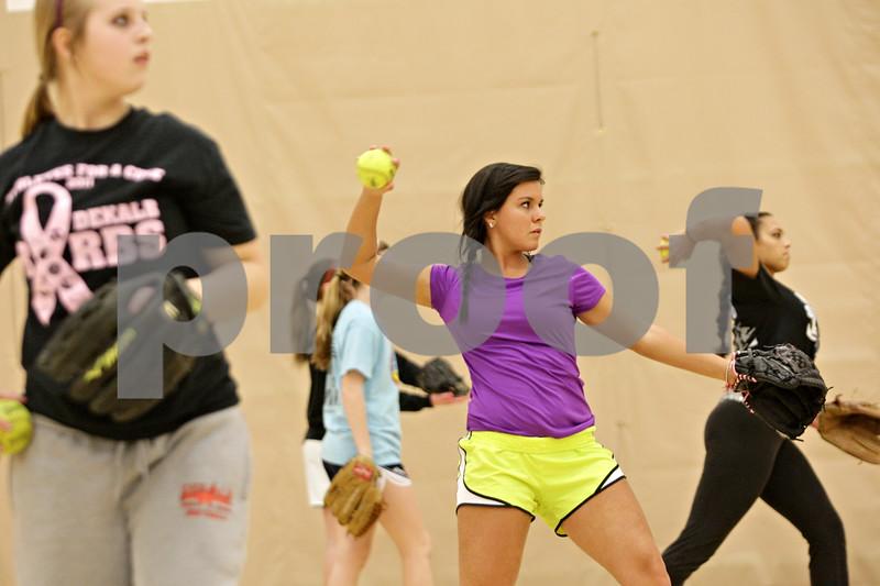 Rob Winner – rwinner@shawmedia.com<br /> <br /> Sabrina Killeen (center) tosses a softball at the start of practice inside the field house at DeKalb High School on Friday, March 15, 2013.