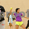 Rob Winner – rwinner@shawmedia.com<br /> <br /> Sabrina Killeen (center) tosses a softball at the start of practice inside the field house at DeKalb High School on Friday, March 15, 2013.
