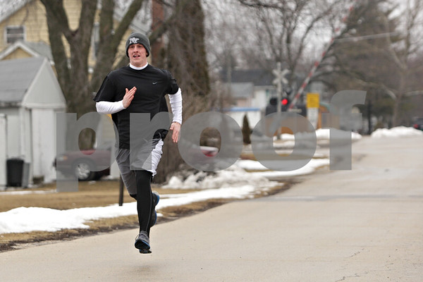 Rob Winner – rwinner@daily-chronicle.com<br /> <br /> Jake Gullstrand runs south on South Birch Street after school near Indian Creek Middle School in Waterman, Ill., Monday, March 18, 2013.