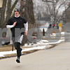 Rob Winner – rwinner@daily-chronicle.com<br /> <br /> Jake Gullstrand runs south on South Birch Street after school near Indian Creek Middle School in Waterman, Ill., Monday, March 18, 2013.