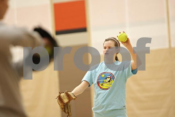 Rob Winner – rwinner@shawmedia.com<br /> <br /> Left handed freshman pitcher Morgan Newport plays catch at the start of softball practice inside the field house at DeKalb High School on Friday, March 15, 2013.
